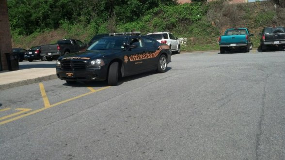 """So car 143 thinks its perfectly fine to park a motor vehicle in a fire lane just to go to the bank?? Right. FCSO {Forsyth County Sheriff's Office } is not above the law. Still a violation."" -Chris Manning photo taken at: 4:42 pm EST"