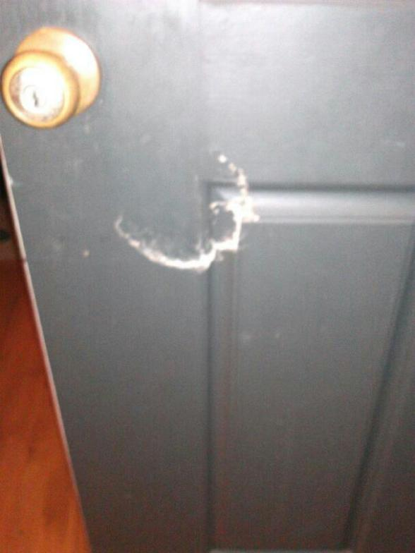 Picture details the mark left by a battering ram when Forsyth County Sheriff's Department / Homeland Security raid. (PICTURE MAY NOT BE REPRODUCED WITHOUT PERMISSION BY TIM MANNING SR. WHO RETAINS ALL RIGHTS TO PHOTO